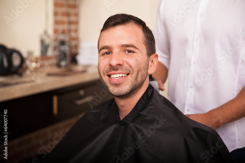 Happy customer in a barber shop