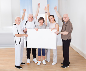 People Holding Blank Billboard At Gym