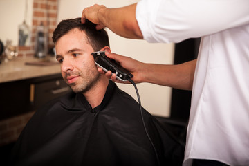 Trimming hair in a barber shop