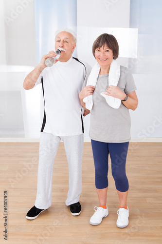 Senior Couple Taking Break After Workout At Gym