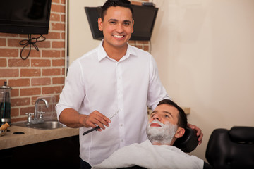 Happy barber ready to shave