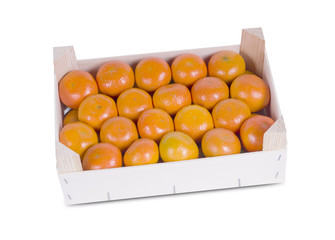 A wood rustic crate full of Clementine Mandarin Oranges.