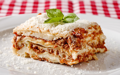 Lasagna served on a white plate
