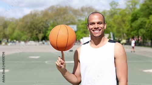 Portrait of Basketball Player spinning a ball