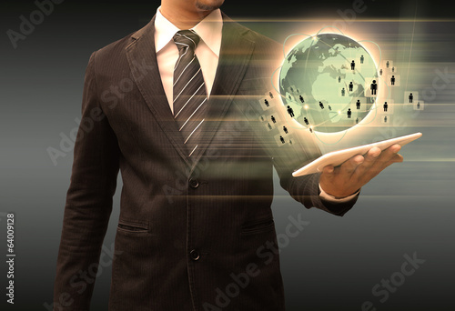 businessman holding tablet world technology and social media