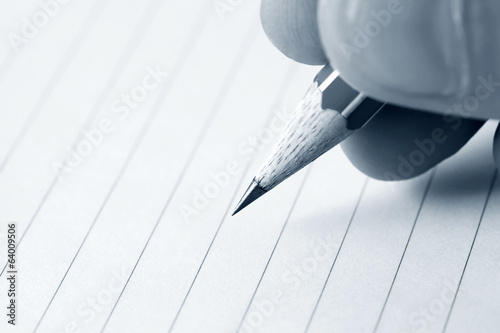 Male hand writing in notebook
