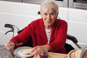 Disabled elderly in kitchen