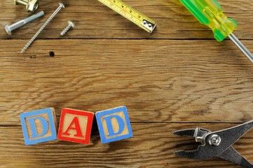 Fathers Day wood background with DAD blocks and tools