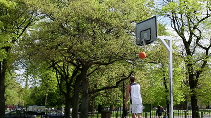 Basketball player scoring a lay up in practice