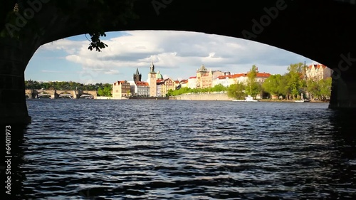 View under the bridge of Charles Bridge in Prague at sunset
