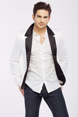 Handsome young guy wearing white jacket