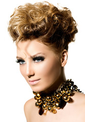 Beautiful model girl with perfect fashion makeup and hair style