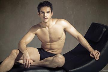 Elegant muscular guy in fashion pose