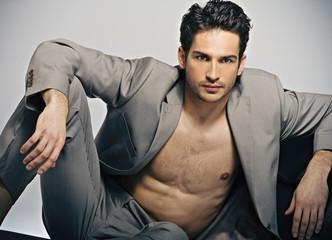 Elegant muscular man in fashion pose