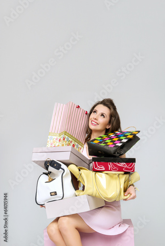 Brunette lady with heap of fashion accesories