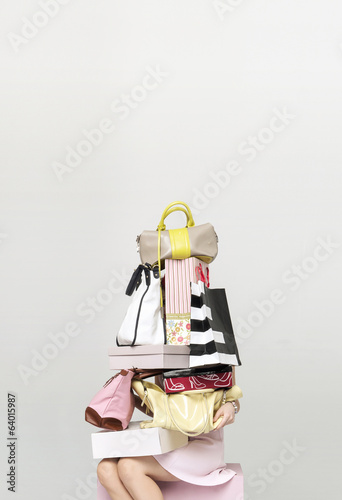 Young woman buying plenty of bags