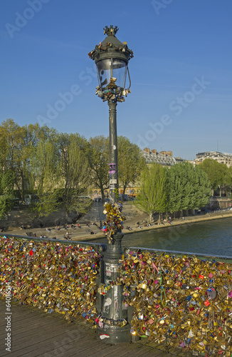 Lamppost and bridge railing, hung with locks of love.