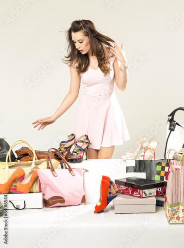 Cheerful brunette woman in the shoe shop