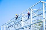 Iron construction assembling, team work - 64016788