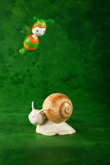 cute puppets handmade, small snail, green background