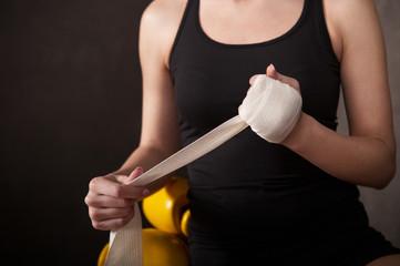Woman boxer wearing white strap on wrist