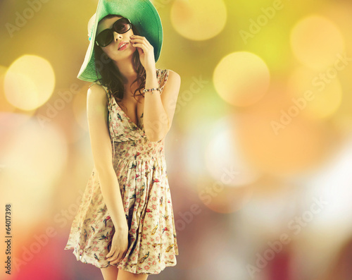 Attractive brunette woman during the hot summer day