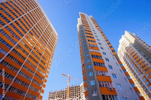 Tall apartment buildings on blue sky background