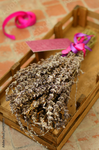 Bunch of dried lavender in wooden tray