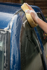 Washing car using sponge