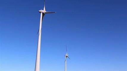 Two white windmills slowly turning