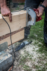 Carpenter cutting with circular saw