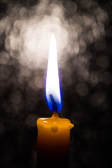 Candle on blur background.