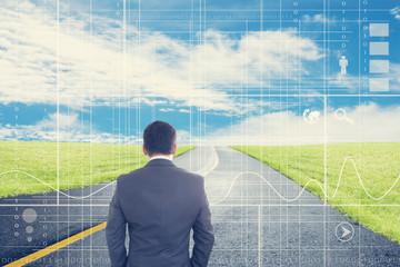 Businessman Looking Forward With Digital Background