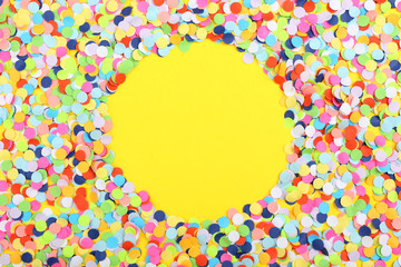 Confetti on yellow background