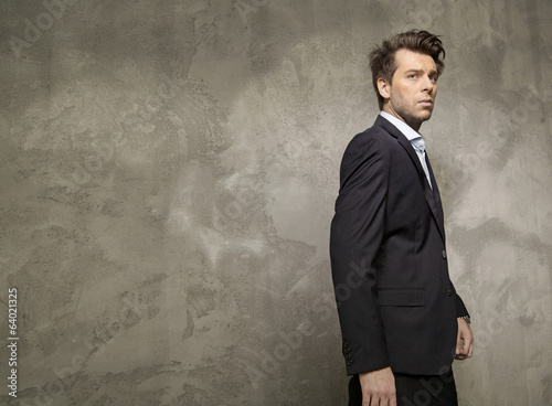 Adult businessman wearing the black suit