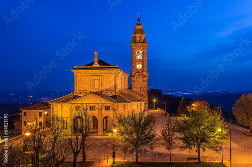 Illuminated catholic church at dawn.