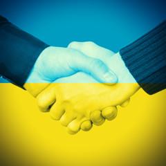 Handshake and Ukrainian Flag