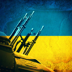 Weapon on Ukrainian Flag © Sabphoto