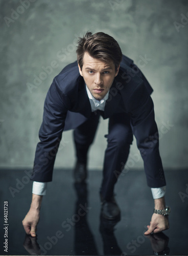 Conceptual photo of young businessman starting his career