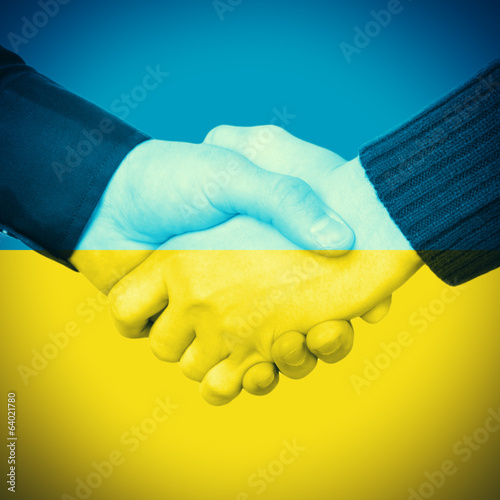 Handshake and Ukrainian Flag