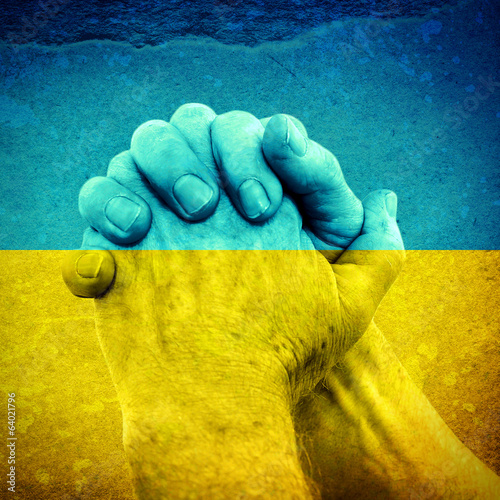 Hands on Ukrainian Flag
