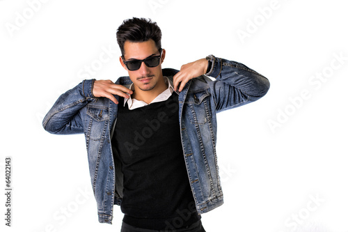 Hip, trendy young man with sunglasses and denim jacket