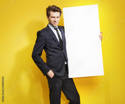 Handsome gentleman carrying white board