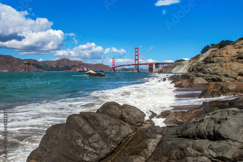 Rocky shoreline and Golden Gate Bridge in San Francisco.