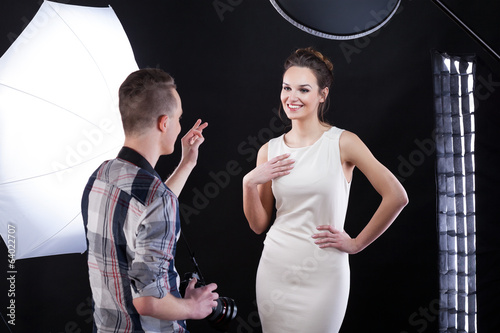 Photpgrapher telling compliment to his model