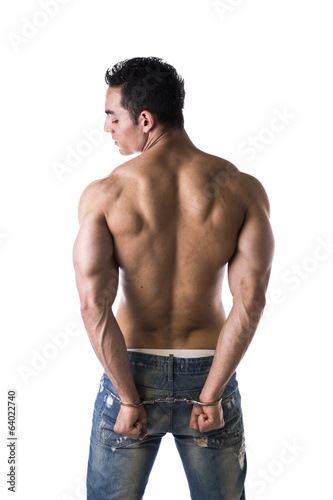Muscular back of male bodybuilder handcuffed