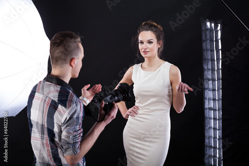 Model dicussing with photographer