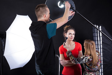 Photographer fixing a flesh light