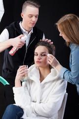 Hairdresser and make-up artist working