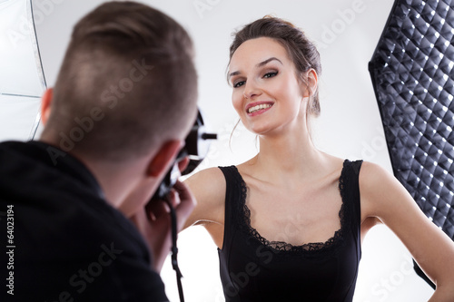 Model smiling to the photo